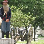 The replica miniature civil war era cannon and Cannoneer.