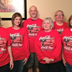 Members of the Coca Cola Committee wearing the new shirts.
