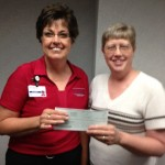 Deb Lamb, right, of Delta Zeta Sorority; Dawn Marnin, Cass County Memorial Hospital Foundation Director