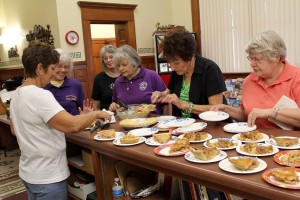 Atlantic Business and Professional Women volunteer at Harvest Fest last year, serving the apple pie from the judged contest. Sponsored by Gade Insurance and Downtowner Café & Catering, the contest is open for commercial and private entries, and pies are to be delivered to the Depot by 2 p.m. for judging. The warm apple pie and smoked pork and brisket are served prior to the Firemen's Parade at the Depot Saturday.