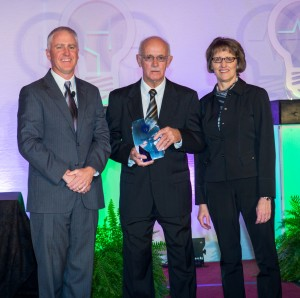 Roger Sandhorst (center) was presented with his Iowa Hospital Association (IHA) Hospital Hero award by Scott Curtis, IHA Board Chairman, and Pat Markham, CEO of Cass County Memorial Hospital, at this fall's IHA Annual Meeting in Des Moines.
