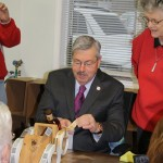 Gov. Branstad putting the label on the millionth bottle at the Templeton Rye distillery in Templeton, Iowa, Wednesday morning.