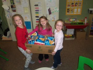 Some students showing off one of the boxes their class collected to donate to our canned food drive. (Photo courtesy Officer Devin Hogue w/the Atlantic P-D)