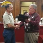 Steve Livengood receives his plaque from Mayor Jones.
