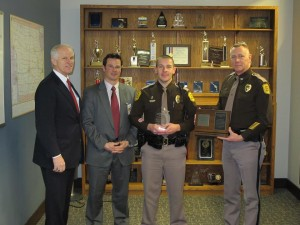 Commissioner Noble, 3M Corporation Government Services Manager Tom Pugh, Trooper Brosam (Center) and Colonel Garrison are shown in the photo provided by the ISP.