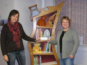 Melanie Petty (Left) presents a check to Librarian Julie Tjepkes. (Photo supplied by Petty)