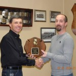 """Mark McNees receives the """"Firefighter of the Year"""" award from 2nd Asst. Fire Chief Tim Cappel."""