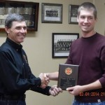 """Chief Mark McNees bestows the """"Rookie of the Year"""" award to Jake Vetter. (Bobbi Jo McNees/Photos)"""