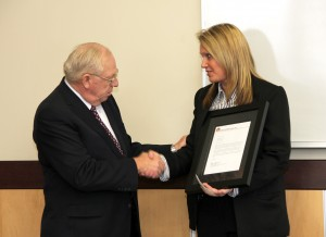 Casey's President/CEO Robert Myers presents a letter of gratitude to Special Agent Shelby McCreedy. (DPS Photo)