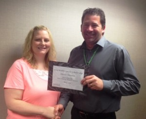 Todd Hudspeth, CEO, presented the award to Heather Foresman.
