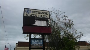 Exchange State Bank sign riddled by hail