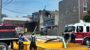 Rear (West) view of the burned structure at 310 Broadway. (Ric Hanson Photos)