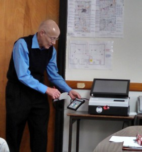 Cass Co. Auditor Dale Sunderman demonstrates a new voting machine for the blind/visually impaired.