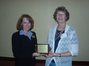 Jolene Smith, a member of Royal Neighbors of America Chapter 1373, Atlantic, IA, at right, was presented a plaque from Sarah Reemtsma on behalf of the Iowa Fraternal Alliance. In recognition of her volunteer efforts in the community, Jolene was honored as a 2014 Iowa  fraternalist of the Year. (Photo provided)