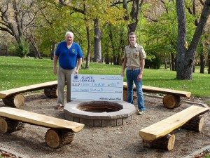 Grant Podhajsky recently completed his Eagle Scout project. He is shown accepting a donation to cover expenses from Merle  Elsberry,representing the Atlantic Lions Club.