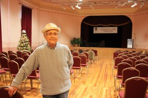 "Writer/Director/Producer Norman Lear stands in the newly named ""Norman Lear Theater"" at the E.E. Warren Opera House, i Greenfield. (Photo submitted)"