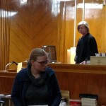 Leatha Slauson enters the courtroom prior to hear sentencing hearing. Judge Kathleen Kilnoski is behind her.