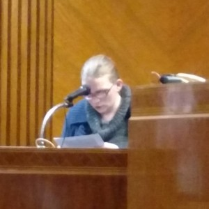 Leatha Slauson reads a statement to the court.