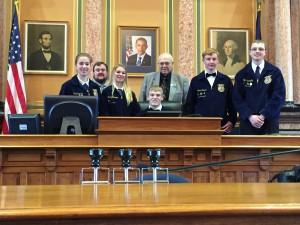 Left to Right Front Haley Carlson, Emily McDermott, Marshal McDermott (seated), Adam Freund, Clayton Saeugling.  Back Row  Eric Miller and Representative Jack Drake.