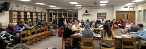 A large crowd packs the Atlantic High School Media Center.