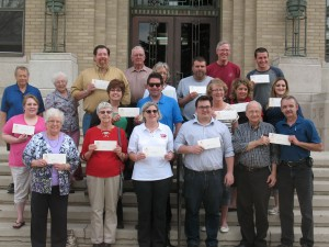 Representatives of various Cass County Organizations proudly display their CCCF grant checks Friday afternoon.