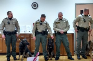(Left) Cass County Dep. Kyle Quist, his partner Vader, and fellow K9 handlers & their partners.