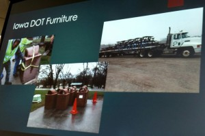 A Power Point image of the cement picnic tables and receptacles being loaded onto a flatbed trailer heading for Atlantic.