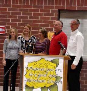 DeLana Harris (Center) receives her Outstanding Teacher of the Year Award