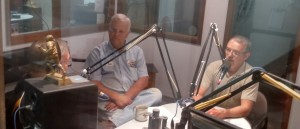 Steve Livengood (right) talks with KJAN's Jim Field about the rally.