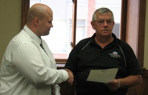 SWITA Transit Director Mark Lander shakes the Mayor's hand after he reads the proclamation.