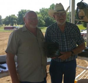 Larry Randell (Left) presents Bob Bebensee with the award (Photo courtesy Carol Bebensee South)