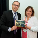 Crystal Starlin, Pharm D, CCMH Pharmacy Director, accepts an award for the340B Drug Pricing Program from Ted Slafsky, 340B President and CEO.