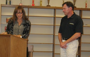 Rodney Hartwig receives recognition from departing Board President Kristy Pellett.