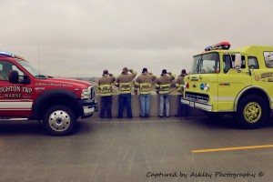 Members of the Marne Fire Department salute a piece of the World Trade Center as it goes by the Marne Interstate Exit to honor the fallen of 9/11. Photo courtest Ashley Haupert