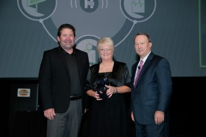 Cathie Alff was presented with a Hospital Hero award by Ted Townsend, Iowa Hospital Association Board Chair, and Todd Hudspeth, Cass County Health System Chief Executive Officer.