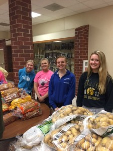 Several Silver Cord students came out to volunteer their time to help stock the mobile food pantry, pictured above are Bailey Schildberg, Ashley Freund, Tori Krogh, and Maddy Williams.