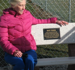 Mary Turner sits on the bench placed in her honor at the Buck Creek Dog Park.
