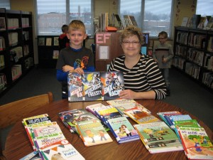 Pictured are Janice Dickerson, school librarian and Trevor's younger brother, Grant Petty. (Photo supplied by Melanie Petty)