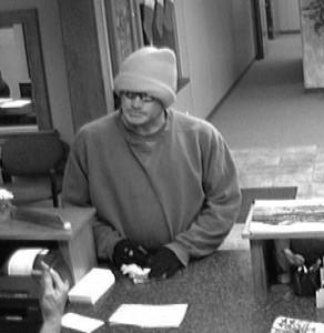 Surveillance still image of robbery suspect.