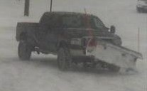 Photo of stolen pickup w/plow attachment.