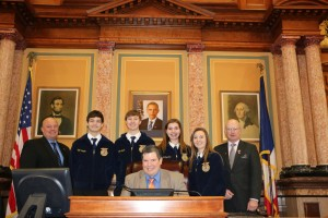 Pictured here are Sen. Jason Schultz, members of the AHSTW FFA chapter, their advisor Jeff Mayes (seated) and Rep. Steve Holt.