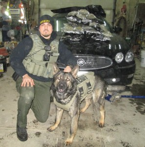 Tyler Shiels w/his K9 partner and the drugs seized. (photo courtesy the Cass Co. S/0)
