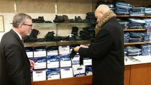 Desmund Adams, candidate for Iowa's Third Congressional District, purchases a pair of leather gloves in November from Mark Krengel, owner, Howard's Clothing, in historic downtown Atlantic.