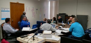 Griswold School Board members contemplate areas to be affected by a budget cut.