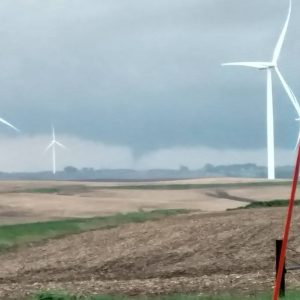"Hope Gettler submitted this photo to the KJAN Facebook page. She said ""We watched the rotation that formed a rope like tornado. It bounced up and down for 10 minutes while it was moving northwest towards Guthrie. This was taken 5 miles north of Adair at 320th St and Elm St."""