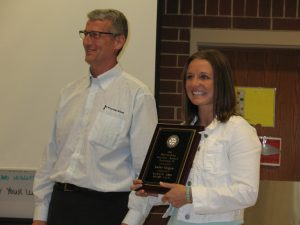 "Jodie Hogue receives her ""Teacher of the Year"" Award from Atlantic Rotary President Ted Robinson"