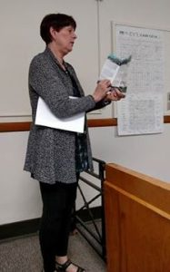 "Kenner Baxter displays a mock-up of the new Cass County Tourism brochure, ""Explore Cass County."""