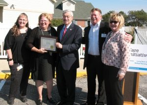 Gov. Terry Branstad presents the award to ASC Adminstrator Kellie Jimerson.