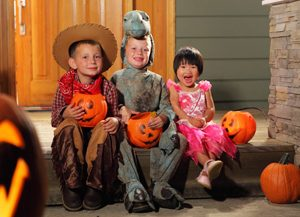 children-sitting-on-porch-halloween-safety-aaa