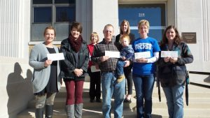 Nonprofit representatives receiving grant awards: 1st row from left to right:  Lexi Christensen and Peggy Tuft, City of Exira; Dillon and Alex Clemsen, Exira Fire & EMS Association; Linda Blomme, Audubon Community Cinema; Abby Rasmussen, Exira Community Club. Back row: Audubon County Community Foundation board members Shelley Burr and Genelle Deist (Chair).